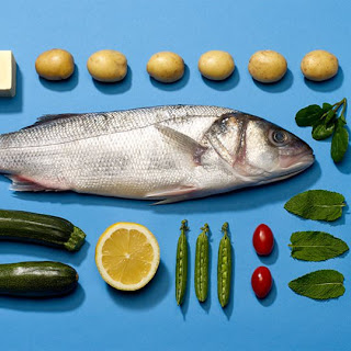 Whole Baked Sea Bass With Courgettes, Baby Potatoes And Peas