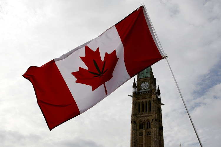 A Canadian flag with a marijuana leaf on it is seen during the annual 4/20 marijuana rally on Parliament Hill in Ottawa, Ontario, Canada on April 20 2017. Picture: REUTERS/CHRIS WATTIE