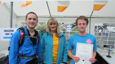 Photo: Breda Ryan with Danny Mills (right), the first to finish the Challenge at 2;00pm and Tom Egan (left), who came in second at 2:14pm.