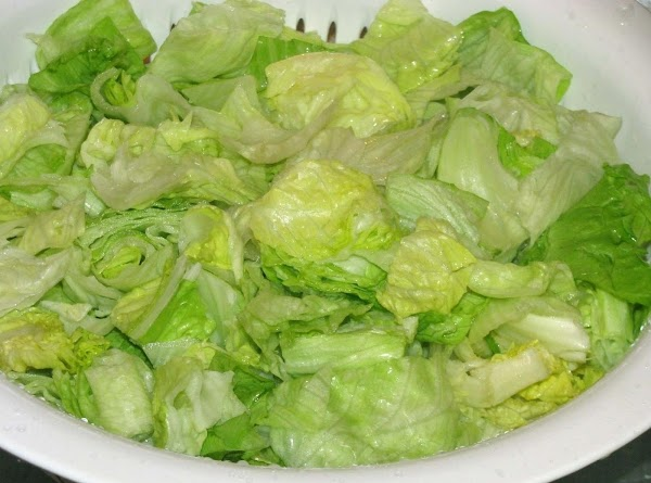Wash the head of lettuce, separating leaves and then drain well. Tear lettuce into...