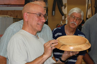 Photo: Mike Colella talks about his uniqely-designed red-oak platter with a rolled edge ...