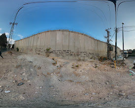 Photo: Separation Wall between East Jerusalem, Israel and the west Bank. It was constructed between after the 2000 intifada to stop suicide bombers from coming into Jerusalem. The cars on the right are on the ancient road to Jericho, which is now obviously cut off by the wall.
