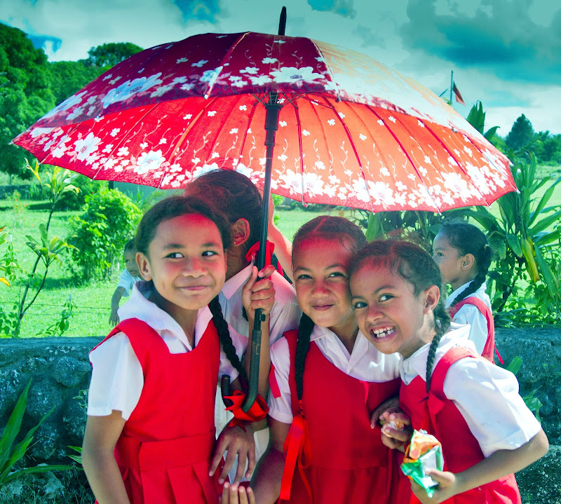A brief downpour doesn't dampen the spirits of these girls in Tonga.