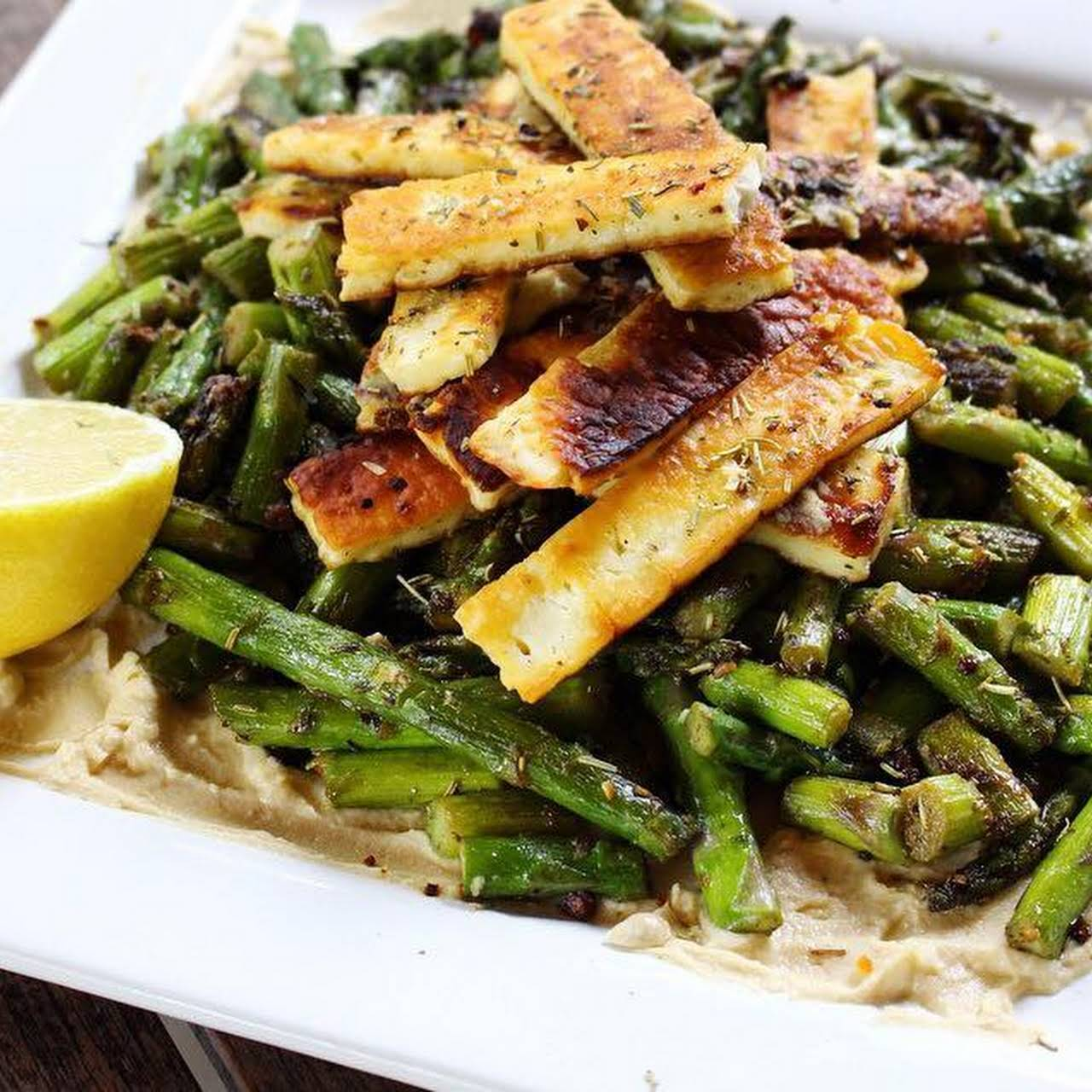 Crispy Herb and Garlic Halloumi on Asparagus and Hummus