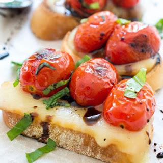 Warm Cherry Tomato Caprese Crostini.