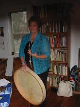 Photo: Carol explaining the grandfather drum.
