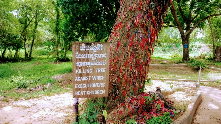 Tree where children were killed - visiting Killing Field at Phnom Penh