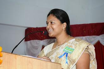 Photo: Mrs. Amrutha Rai - Inviting the Dignitaries and Delegates