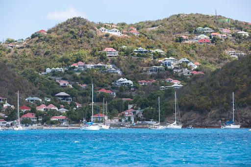 gustavia-harbour-3.jpg - Expensive houses line the waterfront of  Gustavia Harbour in St. Barts.