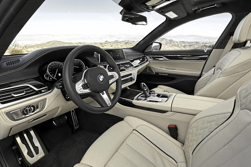 The interior gets some M cosmetic bits, but the rest is all limo luxury. Picture: BMW