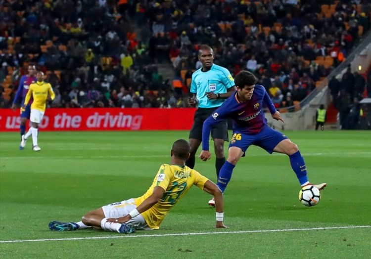 Tiyani Mabunda of Mamelodi Sundowns misses the cross ball which allowed Louis Su‡rez of Barcelona to score the second goal during the International Club Friendly match between Mamelodi Sundowns and Barcelona FC at FNB Stadium on May 16, 2018 in Johannesburg, South Africa.