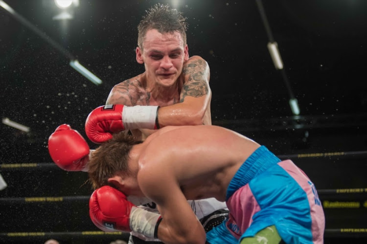 Hekkie Butler from South Africa Joey punches Canoy from Philippines during vacant IBO Light Flyweight title bout between Hekkie Budler and Joey Canoy at Emperors Palace on February 04, 2017 in Johannesburg, South Africa.