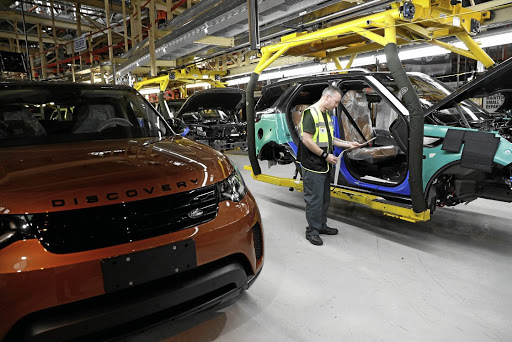 A worker on the assembly line at the Jaguar Land Rover facility in Solihull, Britain. Picture: REUTERS