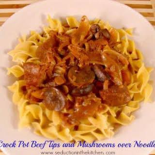 Crock Pot Beef Tips and Mushrooms Over Noodles.