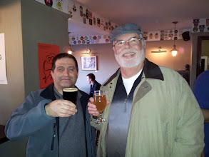 Photo: Dan Rosen and Bob Pike sample from the extensive beer list at Port Street Beer House in Manchester.