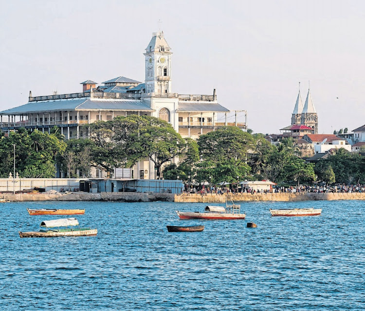 Islands in the sun: The House of Wonders in Stone Town as seen from the ferry from Dar es Salaam. The Zanzibar Archipelago is a few hours by ferry from Dar es Salaam. Picture: 123RF/MAGDALENA PALUCHOWSKA