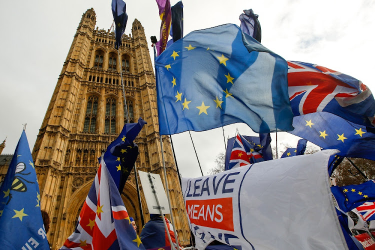 Anti and pro-Brexit demonstrators wave European Union and British flags during demonstrations outside the Houses of Parliament in London, Britain, January 15 2019. Picture: LUKE MACGREGOR/BLOOMBERG