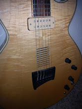 Photo: With a custom DiMarzio neck pickup and a piezo in the bridge, it can easily do double-duty in a live situation.