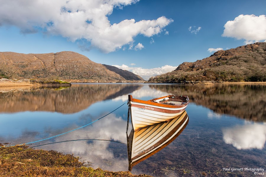 Seeing Double at the Upper Lake by Paul Garnett - Landscapes Waterscapes ( water, upper, co, mountains, ireland, killarney, reflections, lake, kerry, boat )