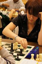 Photo: Natasha Keller, Tualitin senior, deflects Leo Sun's attack in the first round.