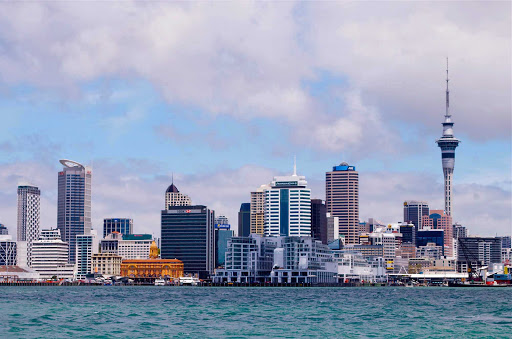 Auckland-skyline-Sky-Tower-Ferry-Building - The Auckland city skyline with a view of the Sky Tower and Ferry Building.