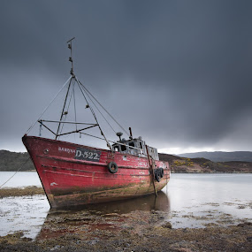 The Sabrina by John Holmes - Transportation Boats ( red, wreck, rain, beached, sea weed, abandonded, clouds, fishing boat, low tide, red hull,  )