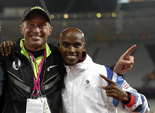 Golden days: Mohamed Farah, right, celebrates winning the 10,000m gold medal at the London Olympics with coach Alberto Salazar. Picture: GETTY IMAGES
