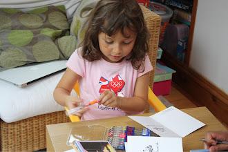 Photo: Aaliya writing Eid cards.