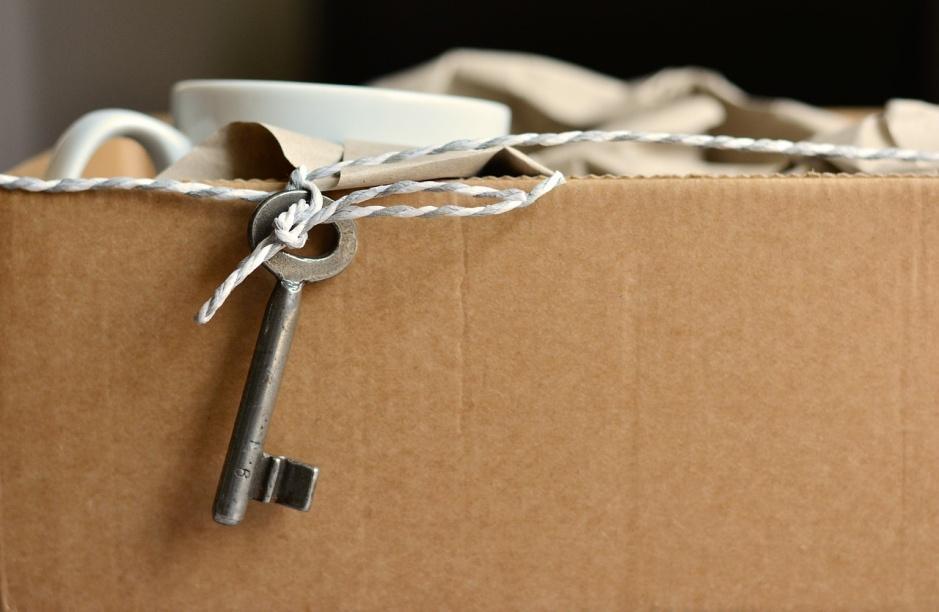 Alt text: A cardboard box and a key.
