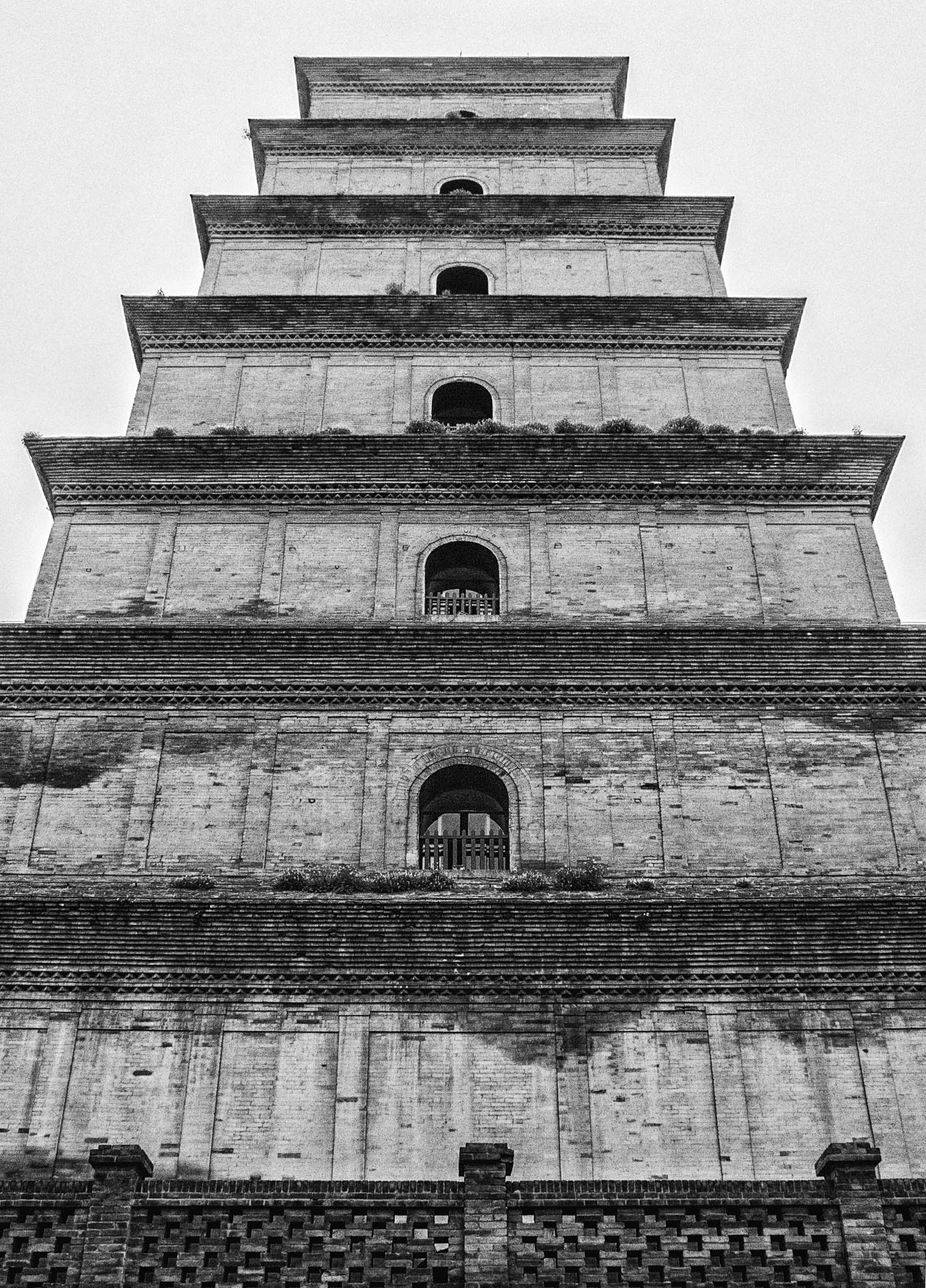 "Photo: Giant Goose Pagoda Xian, China - April 2009  The day we visited the #GiantGoosePagoda  in #Xian , the skies were a uniform grey. Most everything was dulled in the shadowless light. I had an idea that I would take a series of hand-held shots to make into a vertorama later, but . . . well, I missed a bit here and there and it didn't work out the way I envisioned. Here, then, is the ""central"" photo of the series.  This photo was processed in #Lightroom5  and #Nik   #SilverEfexPro .  #Travel   #China"