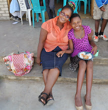 Photo: The girl who fainted - revived! With a visiting teacher, Precious Ntshalintshali (or my best approximation!)