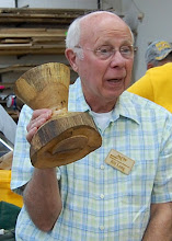 Photo: Bill Long describes his vase that he has finished after getting good comments from the January Show and Tell Critique.
