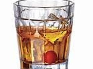 """""""On the Rocks"""": Dash the bitters into the bottom of a highball glass. Pour..."""