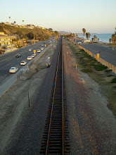 Photo: I was heading over the bridge to a co-worker's birthday bonfire at Doheny, and I loved the way the setting sun was lighting up the rails.