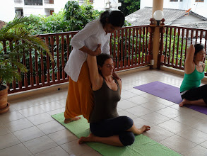 Photo: Jeenal conducting Asanas practice: Yoga teacher trainees performing Gomukhasana (Cow's Face Pose).