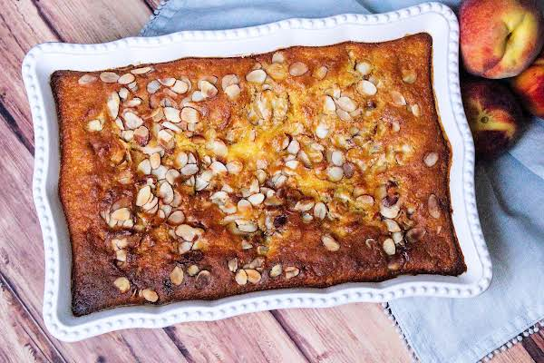 Gooey Peach Cake Baked Until Golden Brown.
