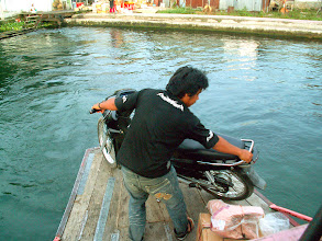 Photo: Parapat - motorcycle on the boat
