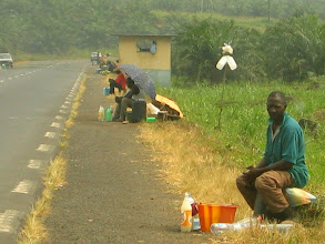 Photo: Selling palm wine on the road side