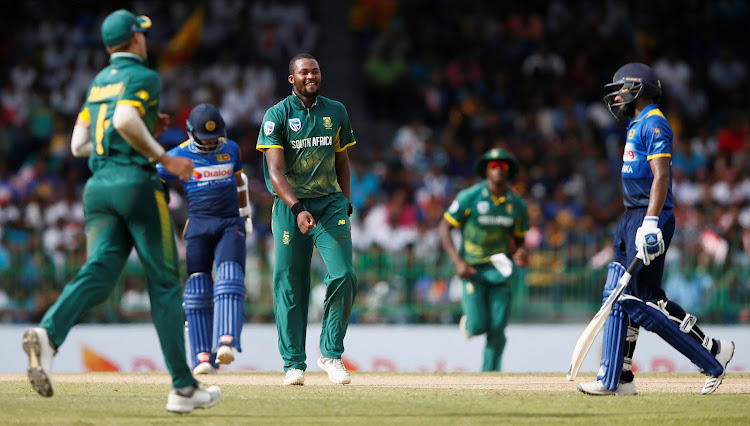 South Africa's Andile Phehlukwayo celebrates after taking the wicket of Sri Lanka's Niroshan Dickwella.