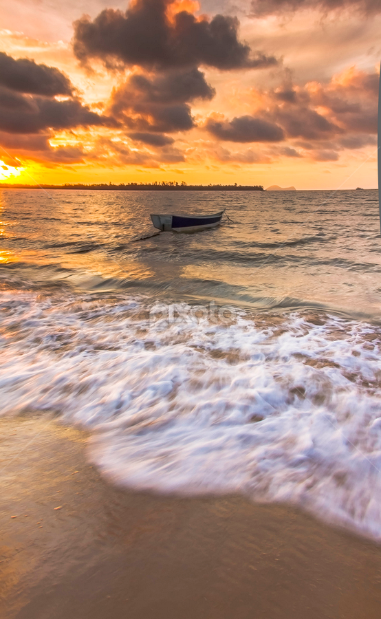 Rushing in. by Victor Sim - Landscapes Waterscapes ( clouds, sky, sunset, waves, evening., beach, boat )
