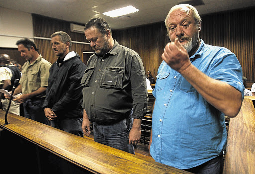 From right: Johan Prinsloo, Hein Boonzaaier, Martin Keevy and Mark Trollip, appear in the Bloemfontein Magistrate's Court. They are accused of plotting to assassinate President Jacob Zuma and members of the ANC executive. File photo