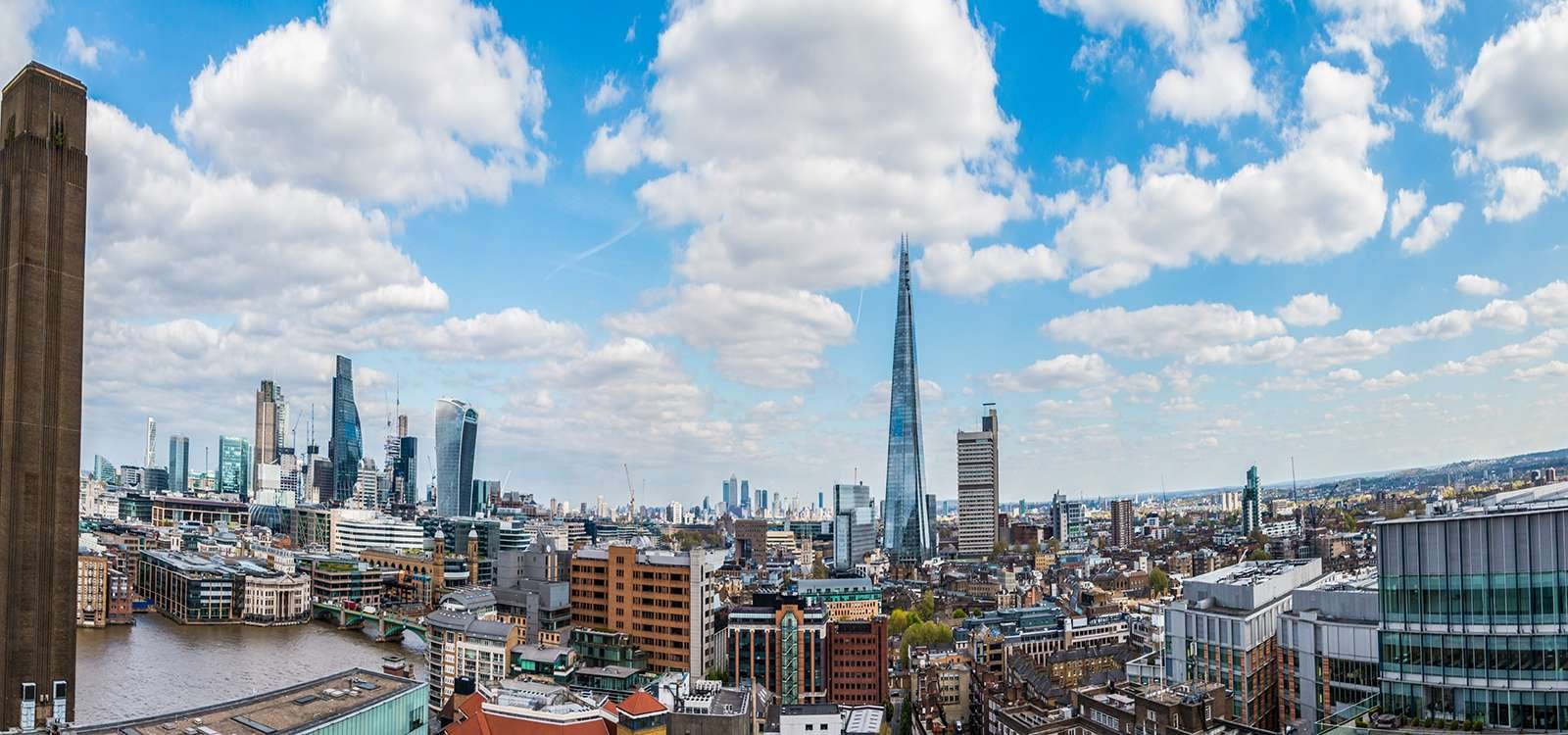 a picture of the london skyline from an office building