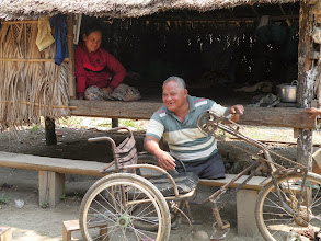 Photo: Landmine Survivor Chhea Ing with wife and home. new roof to be provided.