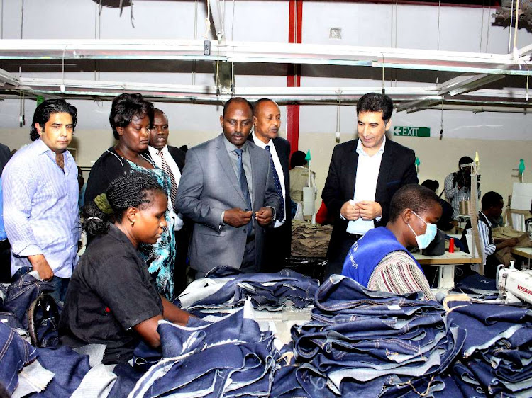 National Treasury CS Ukur Yatani (in grey suite) during a past tour of an Export Processing Zone at Ruaraka/