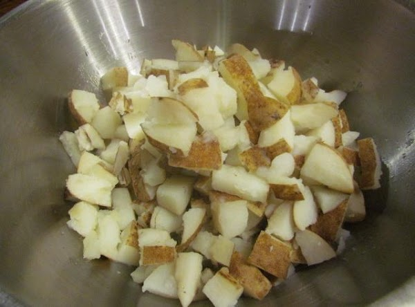 Boil and drain your potatoes then place in a large mixing bowl.