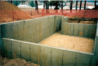 Photo: Note front and back walls are shorter so building can be moved onto basement.