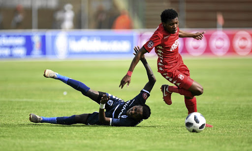 Highlands Parks' Mokete Mogaila evades a tackle from Bidvest Wits' Elias Pelembe during their league match on Saturday.