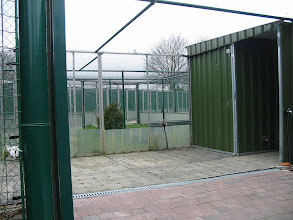 Photo: entry to the pheasantry. in the middle entry with internal look at the outdoor aviaries. right ; view of indoor system with corridor at the backside of each aviary