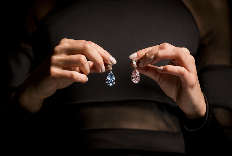 The Apollo and Artemis Diamonds: the 14.54-carat Fancy Vivid Blue diamond and the 16-carat Fancy Intense Pink diamond unveiled at Sotheby's on April 10, 2017.