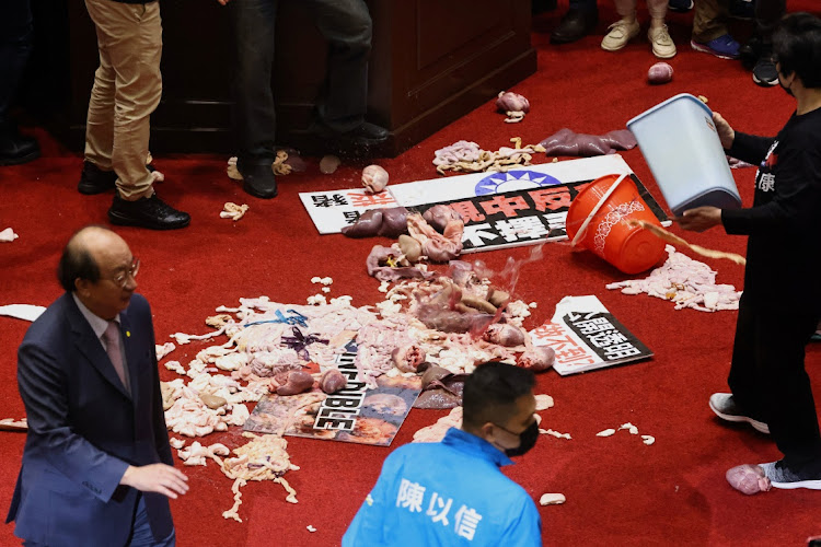 Fists and pig guts fly in Taiwan parliament debate on US pork